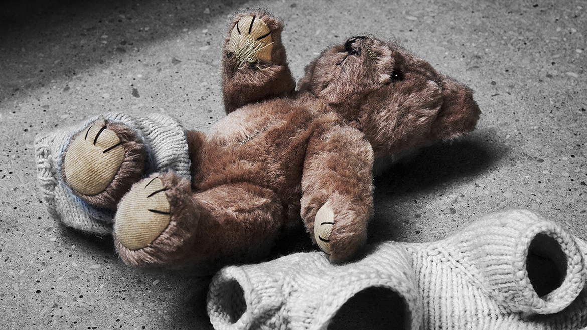 Stripped teddy on concrete floor